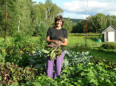 One of our beloved stewards, Kat, in the vegetable garden.